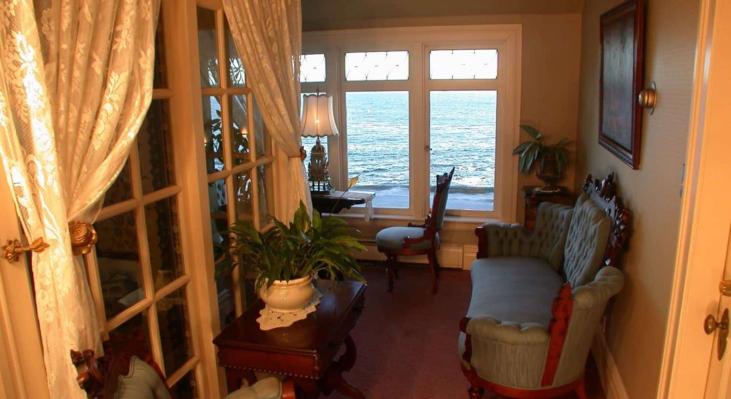 Guest room with ocean views, settee,  and table and two chairs