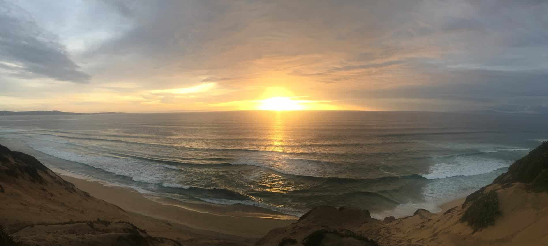 Stunning panoramic view of the sun setting over the Pacific Ocean
